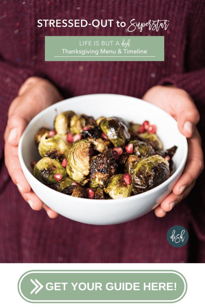 Woman holding bowl of roasted brussel sprouts