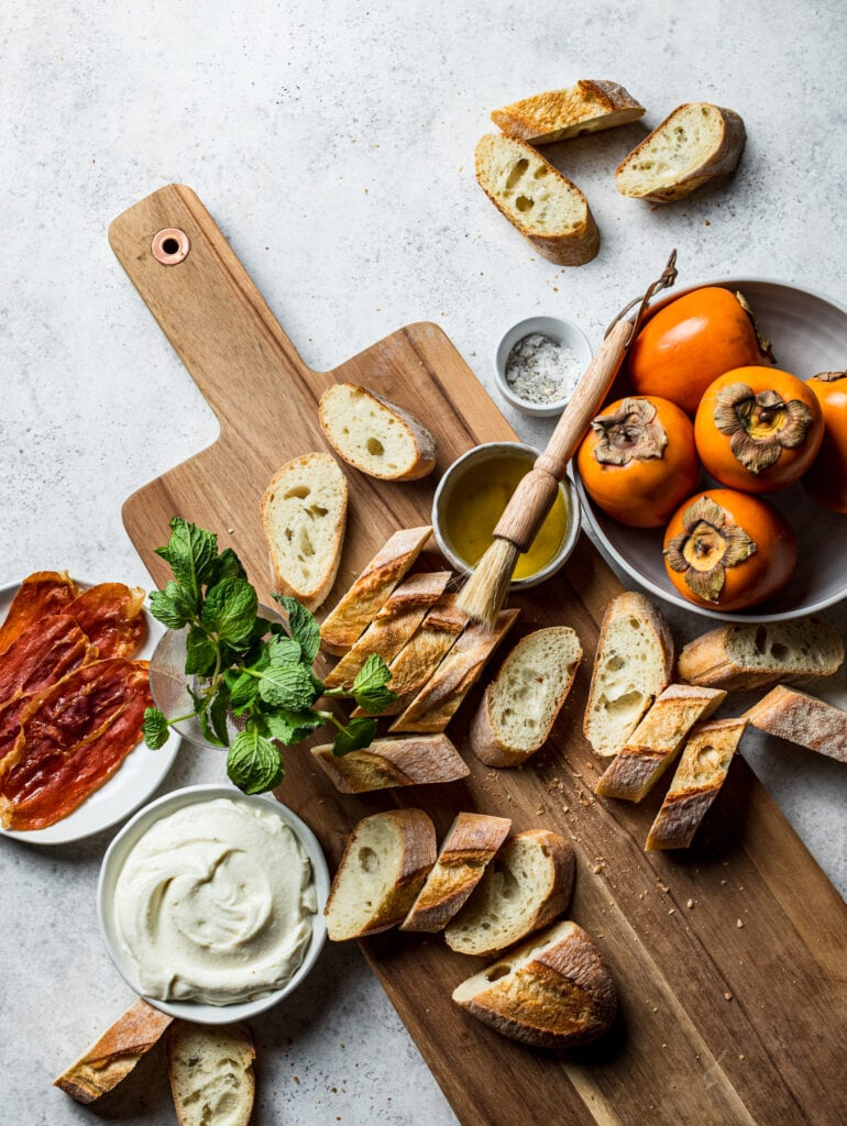 Persimmon Crostini with Crispy Prosciutto and Whipped Ricotta